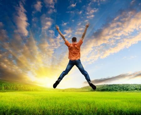 Foto de happy jamping young man - Imagen libre de derechos