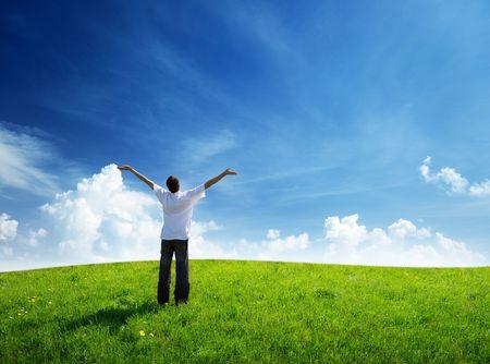 Photo pour field of grass and happy young man - image libre de droit