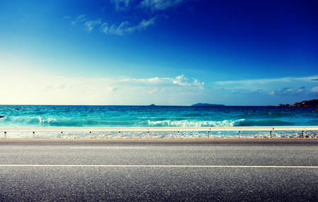 Foto de road and sea in sunset time - Imagen libre de derechos