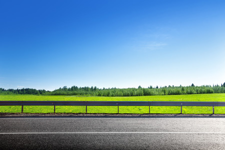 Photo for road and field of spring grass - Royalty Free Image