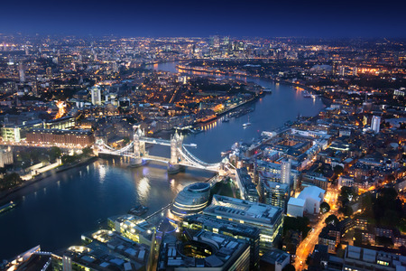 Photo pour London at night with urban architectures and Tower Bridge - image libre de droit