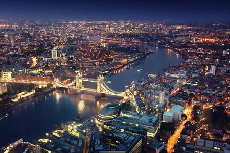 Photo pour London at night with urban architectures and Tower Bridge - image libre de droit