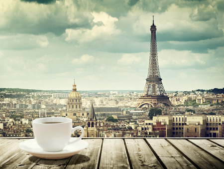 Foto de background with cup of coffee and Eiffel tower in Paris - Imagen libre de derechos