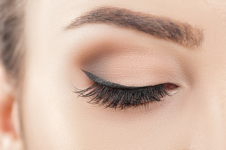 Photo for Close up of female closed eye with eyeshadow and cosmetics on it - Royalty Free Image