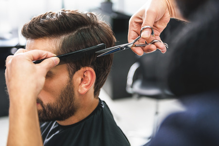 Photo for Barber using scissors and comb - Royalty Free Image
