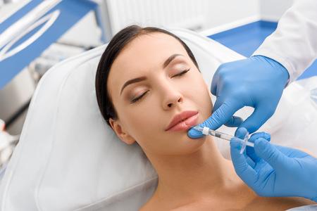 Photo pour Calm girl getting cosmetic procedure - image libre de droit