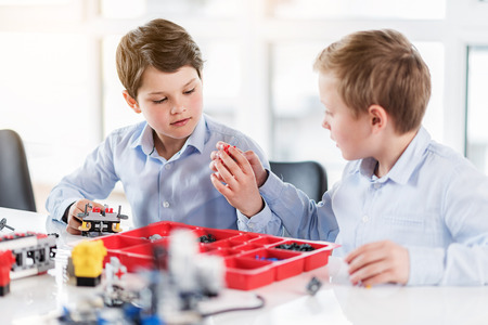 Photo for Curious busy children playing with lego - Royalty Free Image