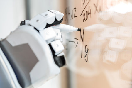 Foto de Smart droid making notes on transparent wall - Imagen libre de derechos