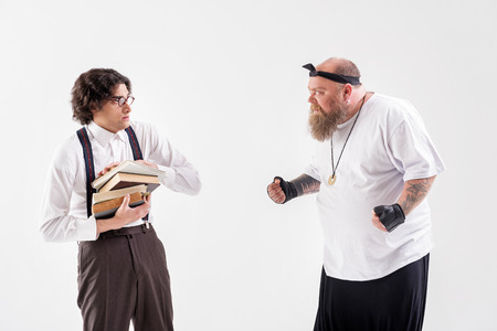 Photo for Fat bearded guy bullying to shy student - Royalty Free Image