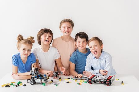 Foto de Cheerful smiling team of young technicians - Imagen libre de derechos