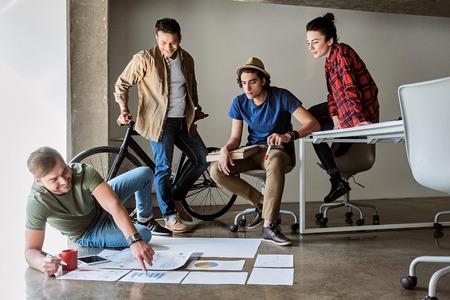 Foto de Cheerful colleagues preparing for business start-up - Imagen libre de derechos