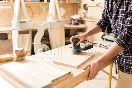 Photo for Woodworker is laboring carefully with professional equipment - Royalty Free Image