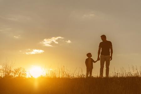 Photo pour Friendly family walking on grass field together - image libre de droit