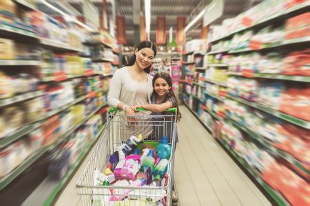 Photo pour Glad members of family in supermarket - image libre de droit
