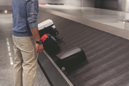 Photo for Man locating near luggage at terminal - Royalty Free Image