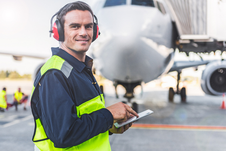 Photo for Happy mechanic having job in airdrome - Royalty Free Image