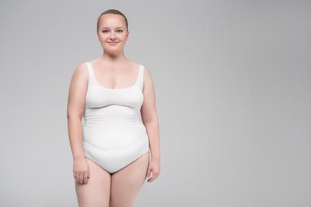 Photo pour Pretty plump girl posing in underclothing - image libre de droit