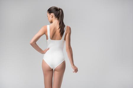 Photo pour Sensual slim girl standing with arm akimbo - image libre de droit