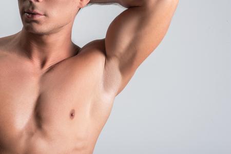 Foto de Pleasant nude man is showing his body parts - Imagen libre de derechos