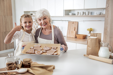 Photo for Cheerful family is satisfied with self-made sweets - Royalty Free Image