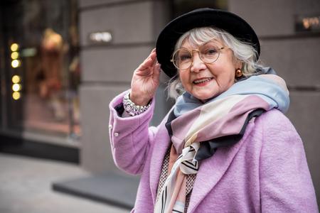 Foto de Joyful senior lady standing in fashionable clothing - Imagen libre de derechos