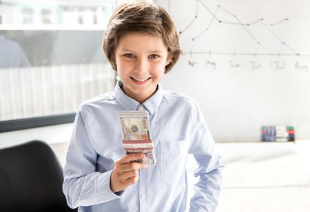 Foto de Delightful child is earning money - Imagen libre de derechos