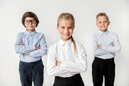 Foto de Optimistic intelligent kids are feeling gladness - Imagen libre de derechos