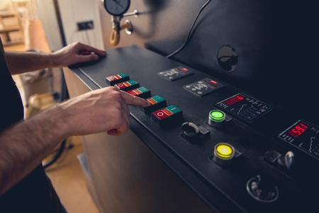 Foto de Close up man hands having job on digital device. He pushing knob on technical equipment. Job concept - Imagen libre de derechos