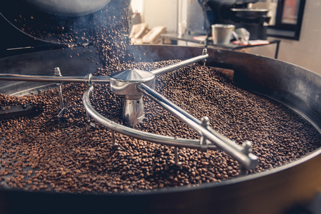 Foto de Aromatic coffee beans situating in modern equipment with grain chiller. Industry concept - Imagen libre de derechos