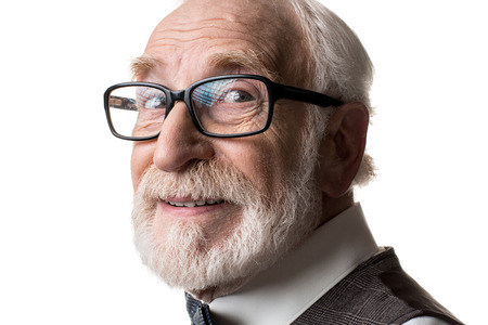 Foto de Good eyesight. Close up of mature male face in framed glasses looking at camera with joy. Isolated on background - Imagen libre de derechos