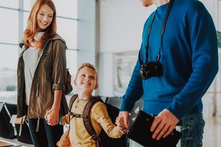 Photo pour Pleased family are preparing for departure at airport. - image libre de droit