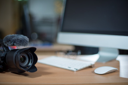 Photo for Video editing workstation with video camera beside monitor - Royalty Free Image