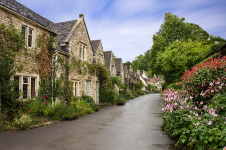 Foto de Beautiful Summer view of street in Castle Combe, Wiltshire, UK - Imagen libre de derechos
