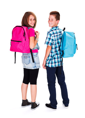 Foto de Kids with backpack on looking back and smiling happily - Imagen libre de derechos