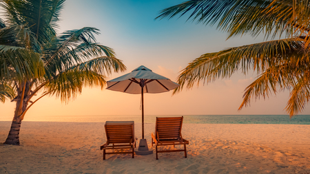 Foto de Beautiful beach. Chairs on the sandy beach near the sea. Summer vacation and holiday concept. Inspirational tropical beach. Tranquil scenery, relaxing beach, tropical landscape design. Moody landscape - Imagen libre de derechos