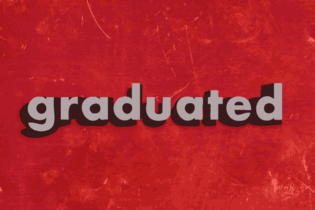 graduated word on red concrete wall