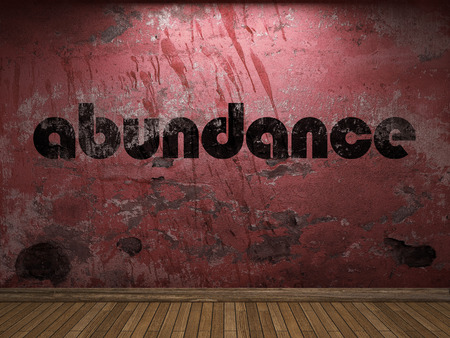 Photo for abundance word on red wall - Royalty Free Image