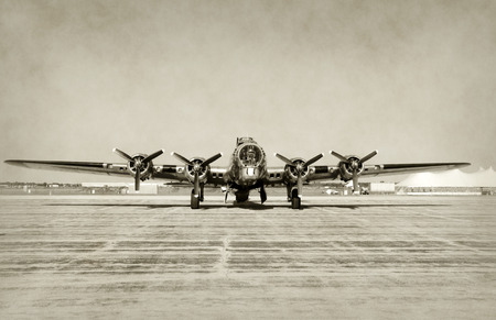 Foto de World War II era heavy bomber front view stained old photo - Imagen libre de derechos