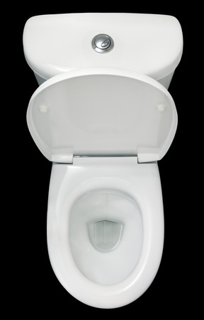 White toilet bowl, isolated on black background, top view