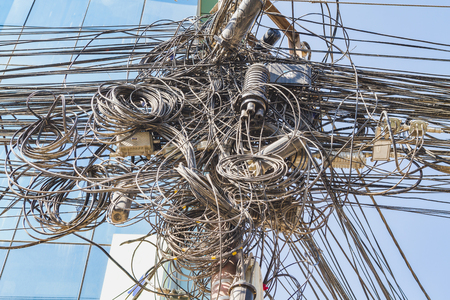 Foto de Massive Tangle of cables and wires in the city of kathmandu Nepal. - Imagen libre de derechos