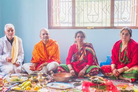 Photo for kathmandu,Nepal - Mar 10,2018: A Hindu Family Worshiping god at home according to hindu rituals in Kathmandu. Hindu Prayers. - Royalty Free Image