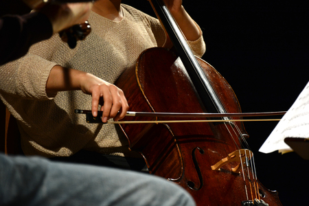 Classical musician playing the Cello during performance