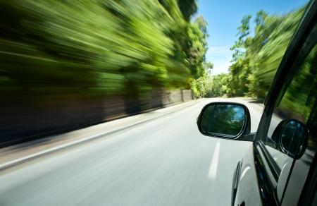 car speeding on a straight road