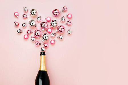 Photo for Champagne bottle with pink and silver christmas balls. Flat lay, top view trendy holiday concept. - Royalty Free Image
