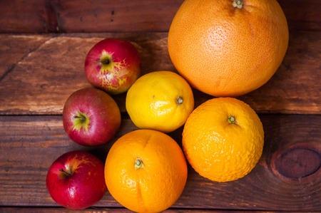 Foto per still life fruit, grapefruit, lemon, red apples, ripe oranges - Immagine Royalty Free