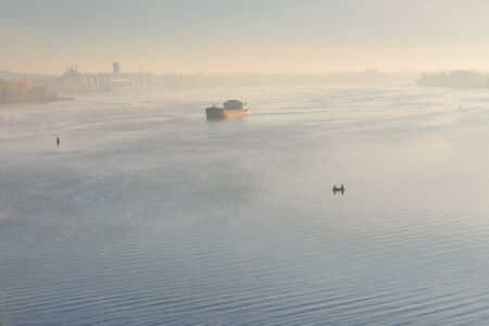 Photo for Cargo ship in fog on river Dnieper - Royalty Free Image