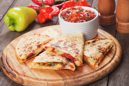 Foto per Mexican quesadillas with cheese, vegetables and salsa - Immagine Royalty Free