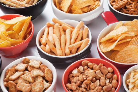 Photo pour Grissini sticks, potato chips and other salty snacks - image libre de droit