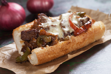 Photo for Philly cheese steak sandwich served on parchment paper - Royalty Free Image