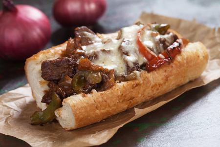 Photo pour Philly cheese steak sandwich served on parchment paper - image libre de droit